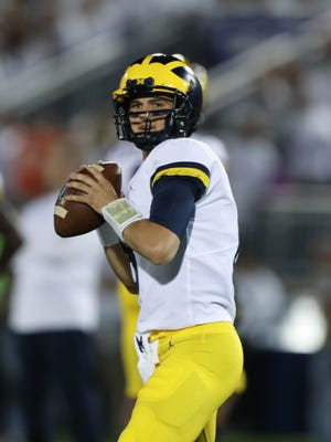 Michigan's John O'Korn warms up before action against Penn State Saturday, October 21, 2017 at Beaver Stadium in University Park , Pa.