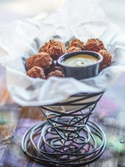 The Social Haus is a good spot to stop in for a drink and an appetizer such as the beer pretzel cheese curds.