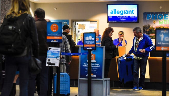 Passengers check in for the first Allegiant Air flight to Punta Gorda, Florida, on Wednesday, Nov. 15, at the St. Cloud Regional Airport.