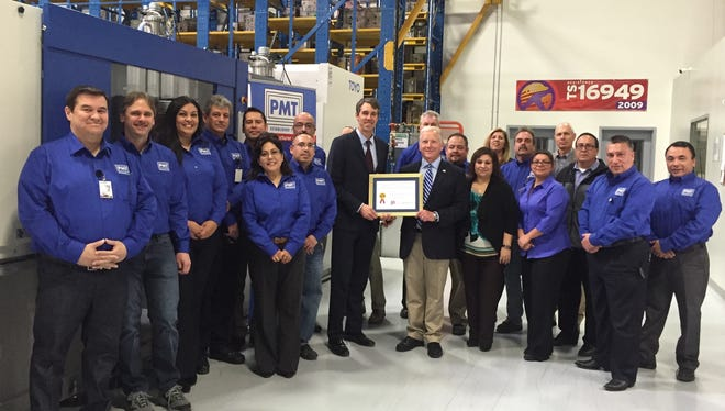 U.S. Rep. Beto O'Rourke presented an award to Plastic Molding Technology last week.