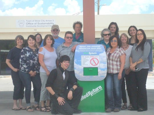 The Youth Substance Abuse Prevention Coalition gathers around a MedReturn kiosk where Grant County residents can safely dispose of unused medications.