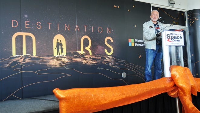 Buzz Aldrin, chairman of ShareSpace Foundation and Apollo 11 astronaut. Destination : Mars media preview at Kennedy Space Center Visitor Complex was help Sunday. The new attraction was developed by Microsoft and JPL, and allows people wearing custom fitted Microsoft Hololens and audio headgear to see a detailed three dimensional view of an area of Mars from near the Curiosity Rover.