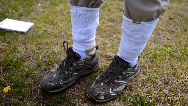 Epidemiologist Bradley Tompkins with the Vermont Department of Health shows the best way to keep ticks out of your pants, by tucking them into your socks. A white socks are the best, because you easily see ticks should they grab on.