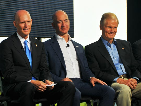 Amazon.com founder and CEO Jeff Bezos announced in September 2015 that his space company, Blue Origin, would manufacture New Glenn rockets at Kennedy Space Center's Exploration Park and launch them from Cape Canaveral Air Force Station's Launch Complex 36. Bezos is flanked by Florida Gov. Rick Scott and U.S. Sen. Bill Nelson.