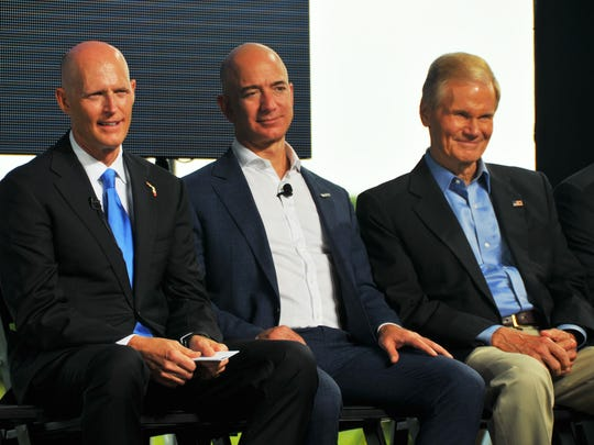 "Amazon.com founder and CEO Jeff Bezos announced at a Tuesday press conference that his space company, Blue Origin, will manufacture their rockets at Exploration Park, and start launching ""later this decade"" from Cape Canaveral Air Force Station's Launch Complex 36. Gov. Rick Scott sitting with Jeff Bezos and Senator Bill Nelson."
