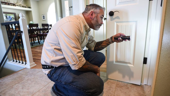 Chad Eusea, owner of Reliable Solutions Home Inspections, examines a closet Monday, June 8, 2015 at a home in Windsor, CO.