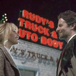 "Jennifer Lawrence and Bradley Cooper in a scene from the film, ""Joy."""