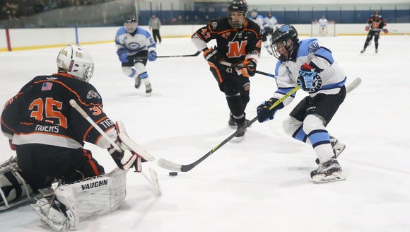 Suffern's Tom McCarren (10) puts a shot past Mamaroneck
