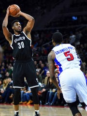 Mar 19, 2016; Auburn Hills, MI, USA; Brooklyn Nets forward Thaddeus Young (30) during the third quarter against the Detroit Pistons at The Palace of Auburn Hills. Mandatory Credit: Tim Fuller-USA TODAY Sports