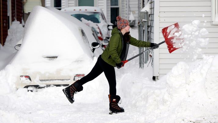 Leanne Galligan shovels out her driveway after a winter