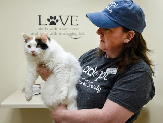Laura Lund, animal care manager, plays with a larger
