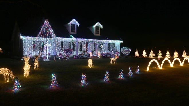 The home of Ricky and Jamie Parker features an animated display set to music with 100,000 lights. While the lights are up, they are taking up donations for Read To Succeed literacy program, which helped Ricky Parker's father, Cecil Parker, learn to read at age 72.