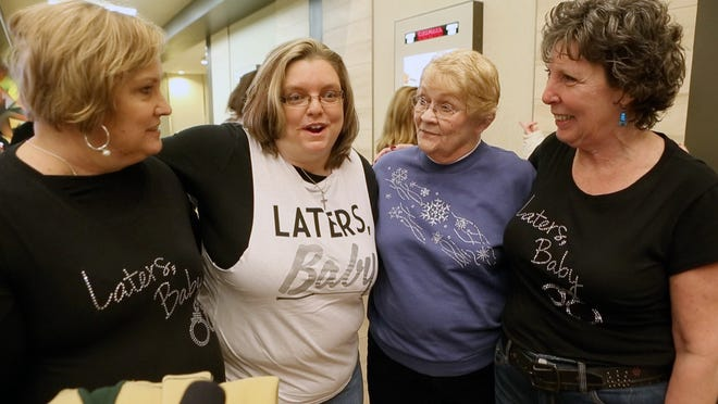 "FIFTY SHADES OF GREY: Fans lined up for opening night of ""Fifty Shades of Grey,"" some of them wearing T-shirts with the catchphrase, ""Laters, Baby."" At Cinemark Christiana and XD at Christiana Mall are Diane Higman, of Wilmington (left); Holly Kennedy, of Elkton, Md.; Pat Paladinetti, of New Castle; and Henrietta Belcher-Stack, of Millsboro."