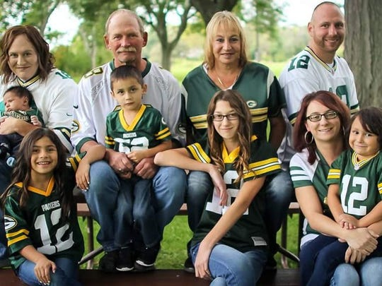 Chuck Wickert, center, with his family. Wickert suffered a heart attack in 2000 at Lambeau Field and was save by two women sitting in the stands near him.