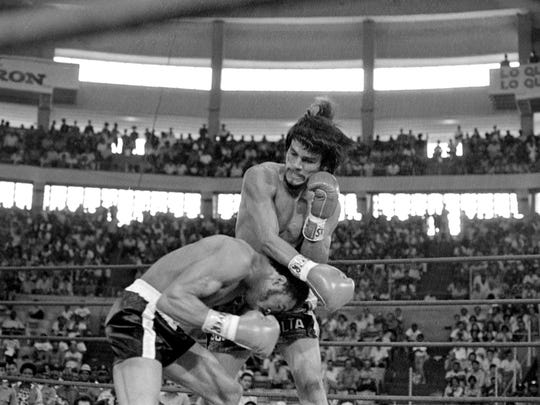 Second round action of WBA World Championship fight in Panama, March 2, 1975 where Roberto Duran of Panama retained his lightweight title by knocking out Ray Lampkin of Portland Oregon. Duran at right. (AP Photo)