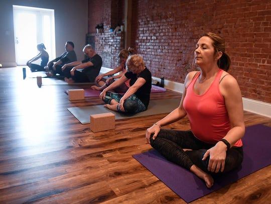 Done' McAlvain (right) Yoga Alternative therapy class