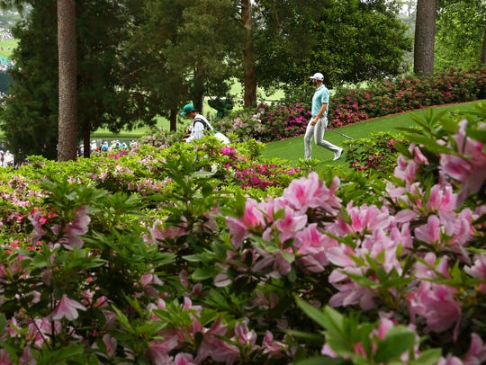 Apr 8, 2019; Augusta, GA, USA; Dustin Johnson walks
