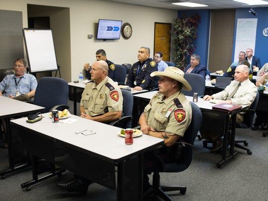 Representatives from several law enforcement agencies,