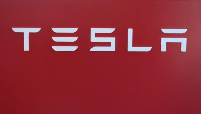 Tesla logos on display at a showroom in Brooklyn, New York, USA, 23 August 2016.