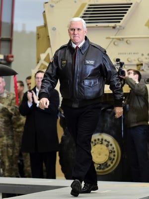 Vice President Pence arrives to speak to troops in a hangar at Bagram Air Base in Afghanistan on Dec. 21, 2017.