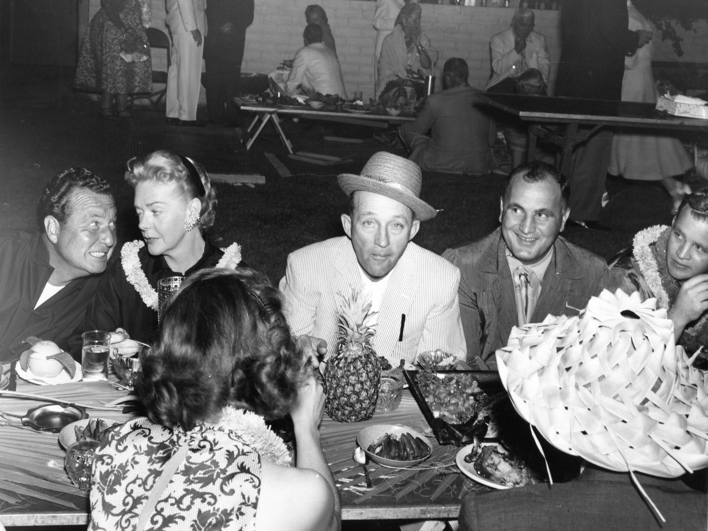 Singer Bing Crosby (center) hosted Attorney General Robert Kennedy at his Palm Desert home according to former FBI agent Clayton Taylor.
