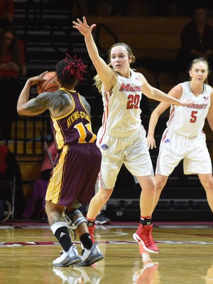 Marist's Hannah Hand, center, attempts to block a throw during the Red Foxes' Jan. 26 game against Iona.
