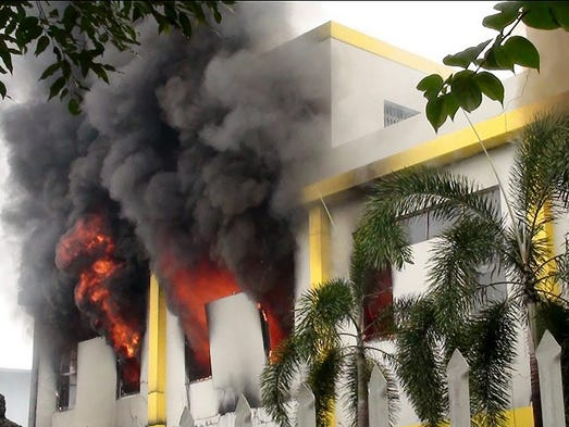 A factory building burns on May 14 in Binh Duong province, Vietnam. Anti-China mobs torched up to 15 foreign-owned factories and trashed many more as anger rose over China's recent placement of an oil rig in offshore waters claimed by Vietnam.