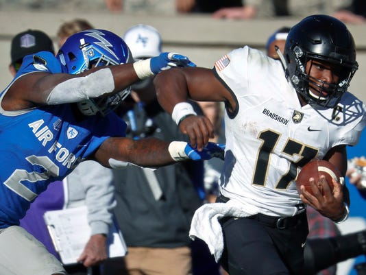 FILE - This Saturday, Nov. 4, 2017, file photo, shows Air Force defensive back Marquis Griffin, left, pushing Army quarterback Ahmad Bradshaw out of play after a long gain in the second half of a NCAA college football game at Air Force Academy, Colo. Bradshaw has already endeared himself to the West Point community by leading the Black Knights to victory over Navy a year ago. (AP Photo/David Zalubowski, File)