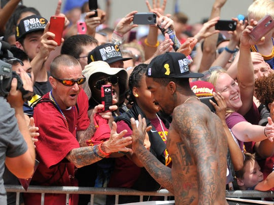 A shirtless J.R. Smith greets fans during the Cavs' NBA Championship parade in June. What better Christmas gift for Smith than his own clothing line?