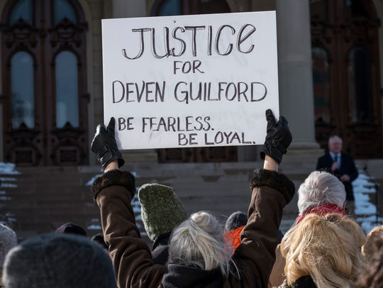 People protest the killing of Deven Guilford at the