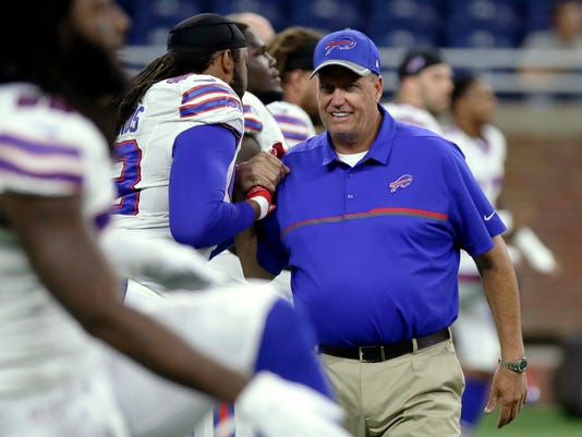 FILE - In this Sept. 1, 2016, file photo, Buffalo Bills coach Rex Ryan talks to players before the team's NFL preseason football game against the Detroit Lions in Detroit. Despite injuries, Ryan insists his defense will be improved from last year, when it finished 19th in yards allowed and managed just 21 sacks _ a franchise low for a 16-game season.  (AP Photo/Duane Burleson, File)