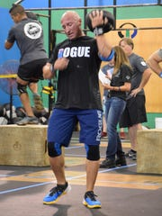 Detective Guy DiMarco of the Northfield Police Department tosses a weighted ball over his shoulder during the Blue Lives Matter Community Strong CrossFit event that was held to benefit Atlantic City Police Officer Joshlee Vadell, who was injured after being shot in the head while investigating a robbery in Atlantic City.