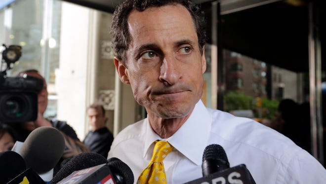 In this July 24, 2013 file photo, then-New York City mayoral candidate Anthony Weiner leaves his apartment building in New York.