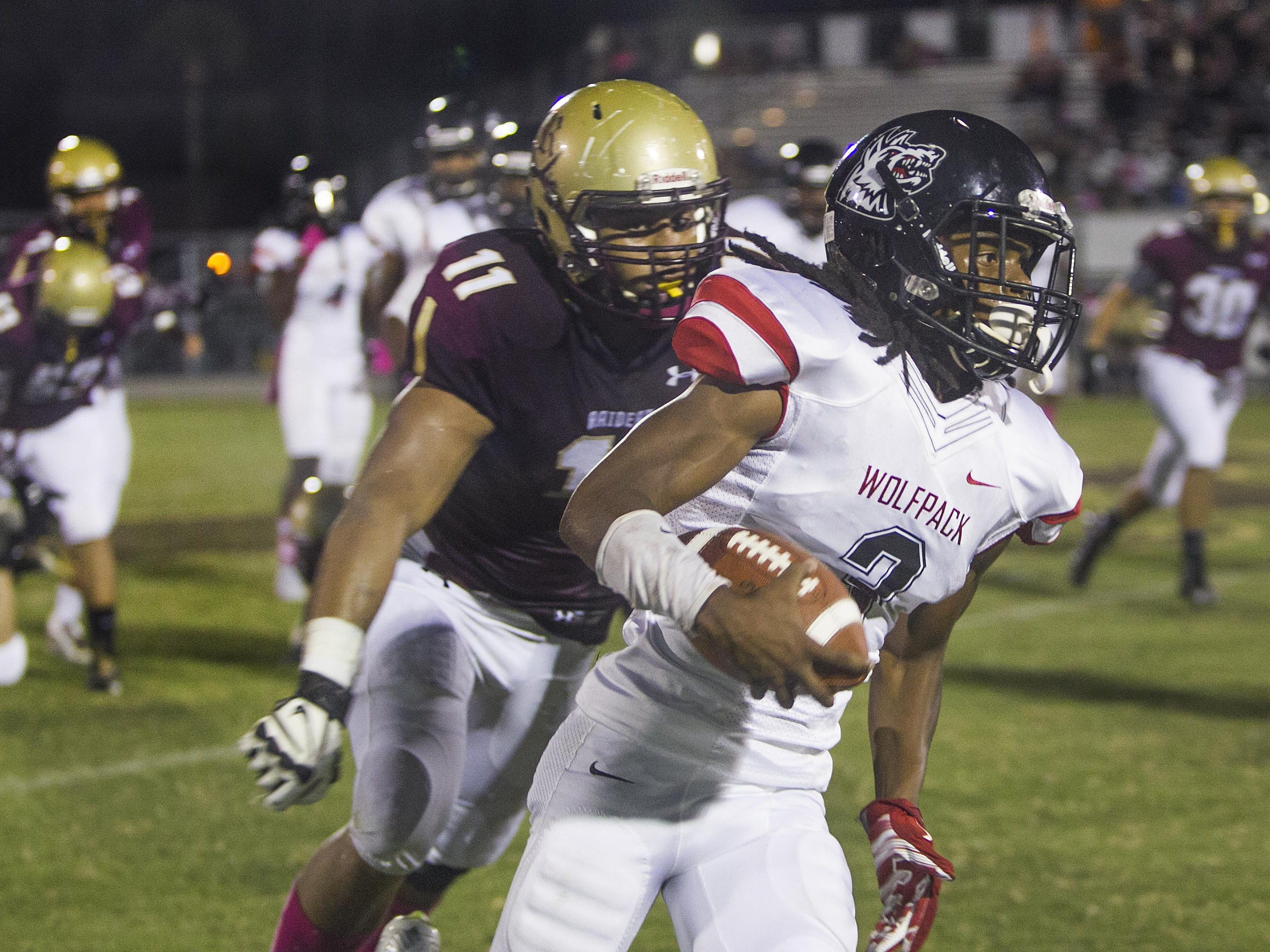 Riverdale defender Jared Tracey comes up behind South Fort Myers ball carrier Ke'Shon Murray but can't catch up; the result is a SFM touchdown Friday as the Raiders host the Wolfpack in East Fort Myers.