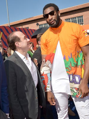 Viacom CEO Philippe Dauman and Detroit Pistons center Andre Drummond, right, attend the Nickelodeon Kids Choice awards July 16, 2015, in Westwood, California.