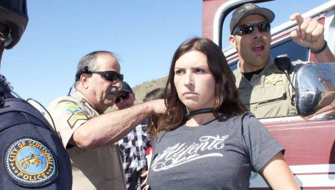 Jacinta Gonzalez had locked her neck to a vehicle blocking the principal route to the Donald Trump rally in Fountain Hills Saturday.