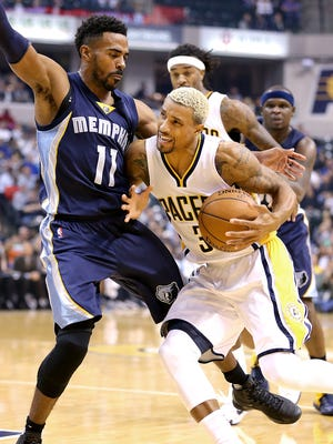Indiana Pacers guard George Hill (3) drives on Memphis Grizzlies guard Mike Conley (11) in the first half of their game. The Indiana Pacers play the Memphis Grizzlies in their home opener Thursday, October 29, 2015, at Bankers Life Fieldhouse.