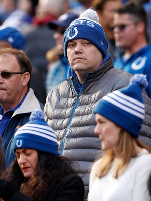 Colts fans find ways to keep warm with the roof and window open during their game at Lucas Oil Stadium Sunday, Nov. 26, 2017. The Tennessee Titans defeated the Indianapolis Colts 20-17.