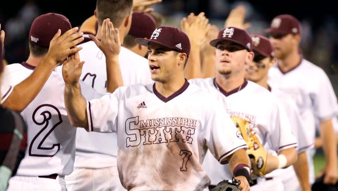 Mississippi State outfielder Jacob Robson congratulates his teammates after beating Louisiana Tech on June 5, 2016.