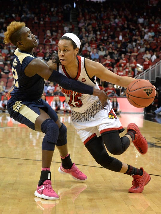 Pittsburgh forward Yacine Diop, left, attempts to tip the ball away from Louisville guard Asia Durr (25) during the second half of an NCAA college basketball game, Sunday, Feb. 25, 2018, in Louisville, Ky. (AP Photo/Timothy D. Easley)