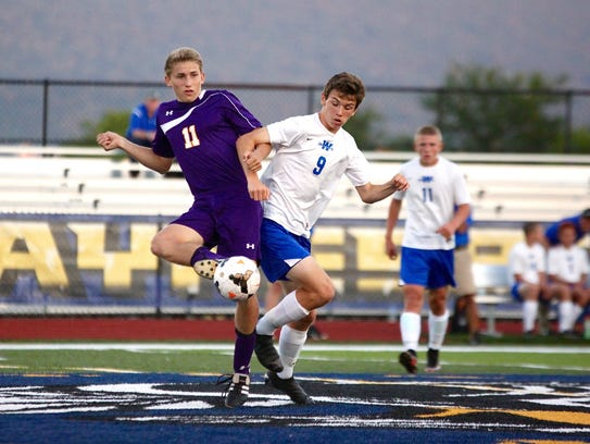 3. Waynesboro's Aaron Tylicki tries to go for the ball