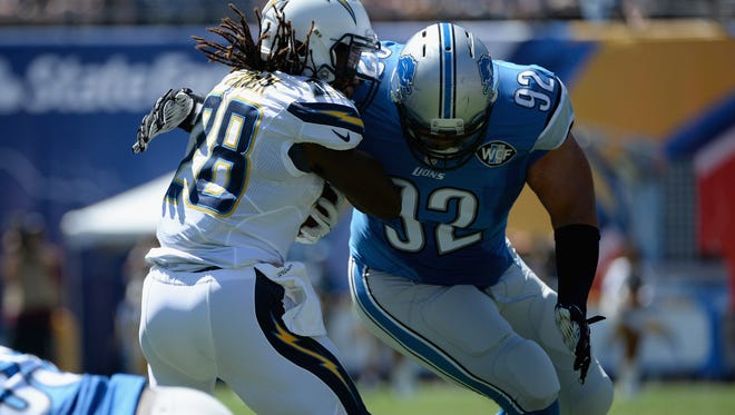 Running back Melvin Gordon of the San Diego Chargers is tackled by defensive tackle Haloti Ngata of the Detroit Lions at Qualcomm Stadium on Sept. 13, 2015.