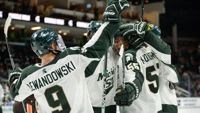 Michigan State's Mitchell Lewandowski (9) scored the game-winning goal with 1:14 to play in Friday night's game vs. Northern Michigan.
