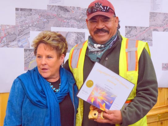 Joe Perez received congratulations from Debi Lee for