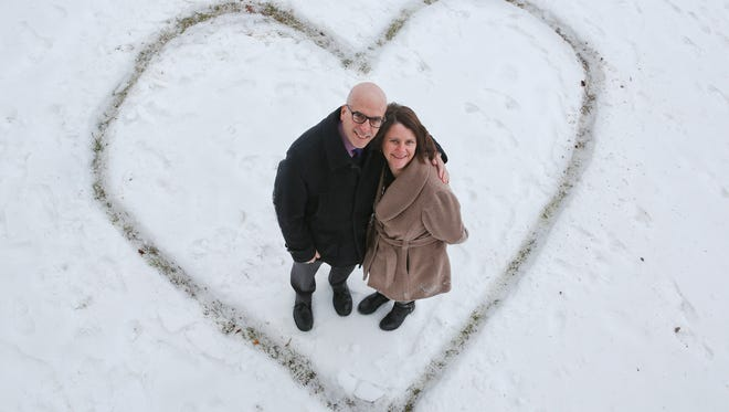 """Joe D'Ambrosio, left, and Annatjie Faul of the University of Louisville's Kent School of Social Work have developed a new """"Love Survey"""" that seeks to measure society feelings such as compassion and empathy."""
