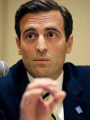 Adam Laxalt speaks during a debate against Nevada Secretary of State Ross Miller at the Nevada Press Association annual convention, Saturday, Sept. 20, 2014, in Las Vegas. The two are facing each other in a race for attorney general in Nevada. (AP Photo/John Locher)