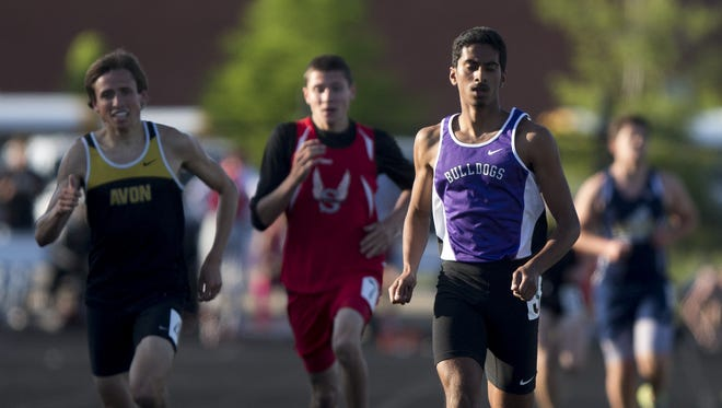 Hari Sathyamurthy (right), of Brownsburg High School wins the 1,600 meter race, IHSAA Boys Track and Field Sectional, Plainfield High School, Plainfield, Thursday, May 21, 2015.