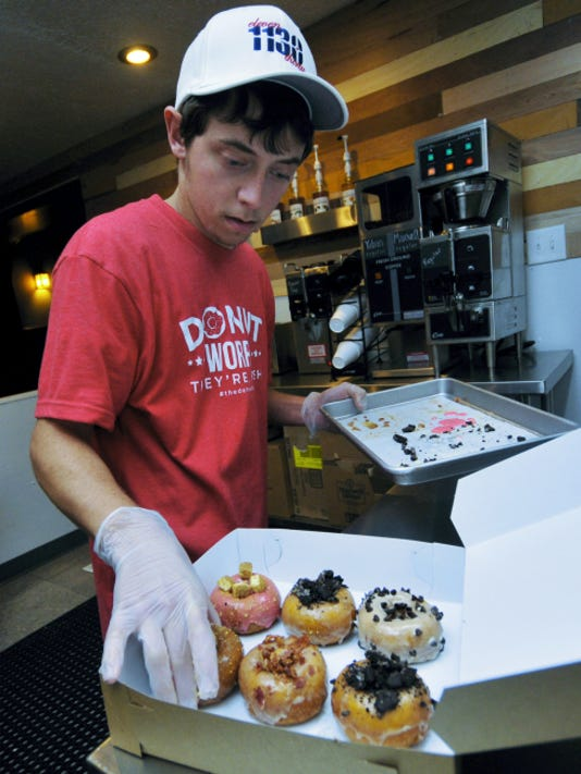 Brandon Bless makes donuts Tuesday, Oct. 27. The Doh-Nuh T Company is the latest place for made-to-order donuts, located beside Texas Lunch on Lincoln Way West, Chambersburg.
