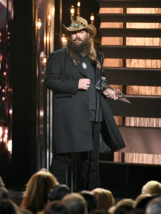 Chris Stapleton accepts the award for male vocalist of the year.