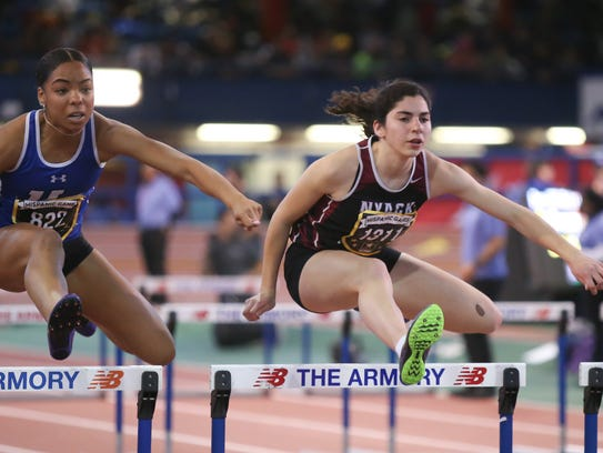 Nyack's Louise Jones, right, runs in the finals of
